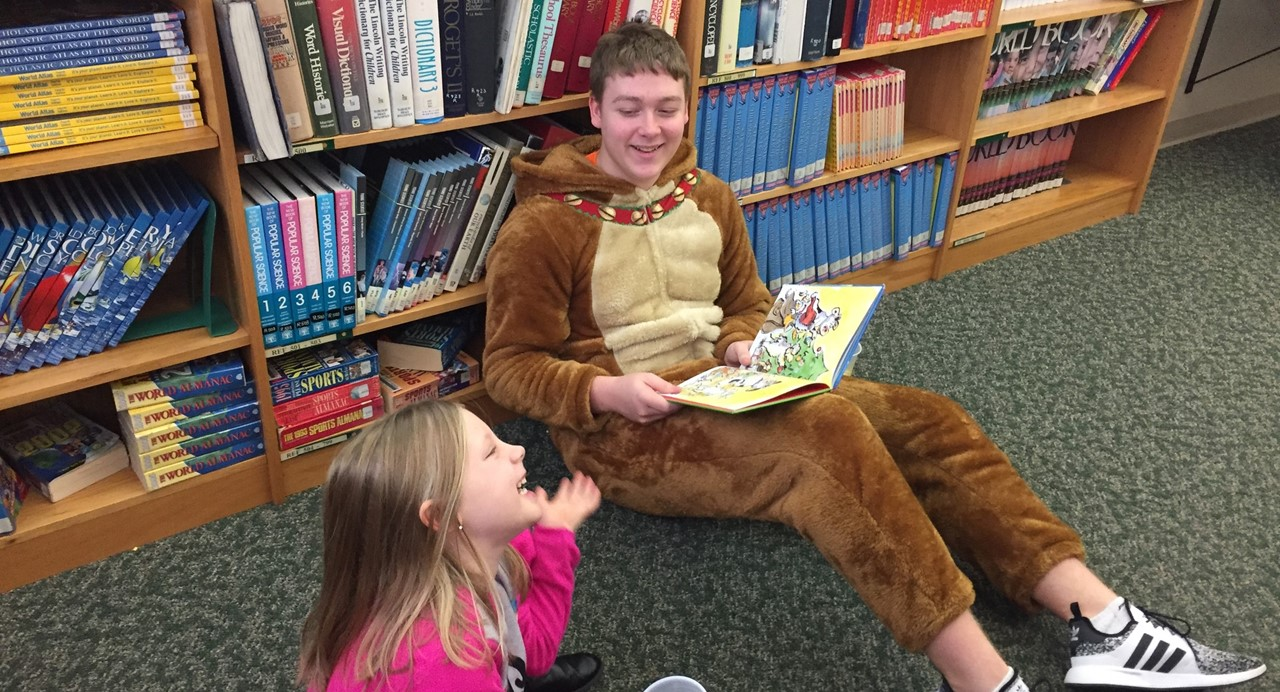 Senior students reading to Kindergarten